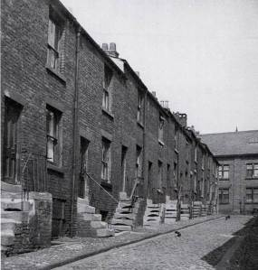 These weavers' cottages in Mount Pleasant, Preston, were demolished in the 1960s. Note the windowed cellars, to allow light for working in the humid basement conditions. From Preston Digital Archive (see http://www.flickr.com/photos/rpsmithbarney/5213242118/)
