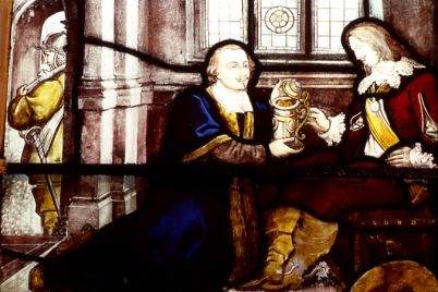 A series of stained glass windows at St John's depicts its benefactor, John Harrison. This depicts an apocryphal tale in which Harrison presented Charles I, imprisoned in Leeds, with a tankard of gold coins disguised as a draught of ale.