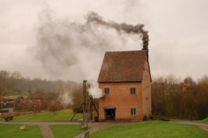 A working replica of the first Newcomen steam engine, 1709, built and operated at the Black Country Living Museum, Dudley. The engine is a similar size, and uses a similar amount of mineral coal, as many of the facilities that produced beer, spirits, glass, and bricks in early modern London