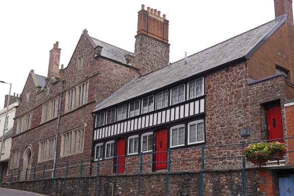 Slee's almshouses at Tiverton, founded in 1610 for six single women, and, to the left, Great House of St George, constructed 1603-14 for George Slee, after the 1598 fire.