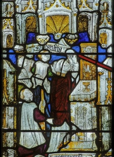 Stained glass depicting elevation of the host, Doddiscombe church