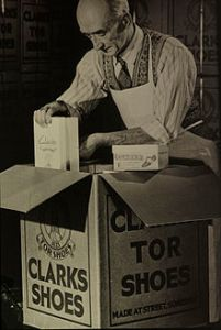 Clarks_vintage_photograph_-_man_packing_Clarks_Tor_Shoes